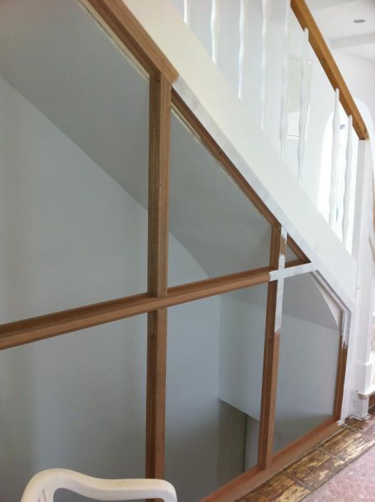 Windfang für die Holztreppe als Glaselement